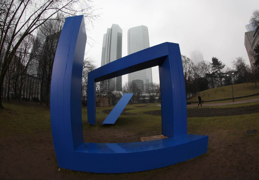 A three-dimensional Deutsche Bank logo stands in front of the Deutsche Bank headquarters prior to a re-opening ceremony in Frankfurt February 24, 2011. After a three-year renovation period the two Deutsche Bank towers are re-opened. Picture taken with a fisheye lens. REUTERS/Ralph Orlowski (GERMANY - Tags: BUSINESS)